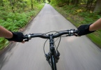 Biking on the road in forest